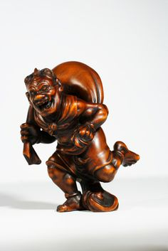Netsuke= Futen the god of wind with a sack of wind on his back