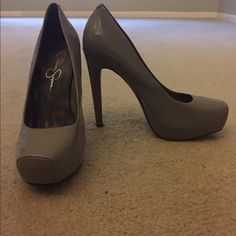"""Jessica Simpson Landy Heel Landy has a grey patent leather upper with a squared off closed toe. This style showcases a 3/4 inch hidden platform and a 5"""" heel. Only wore shoes once -- nearly new. Jessica Simpson Shoes Heels"""