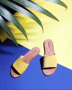 The Boden mustard pony slide as shot by Claire Brayford. Easy pack slip on flats in a rather fancy leather, pick up a pair in white or leopard and promptly pack them in your summer vacation suitcase.