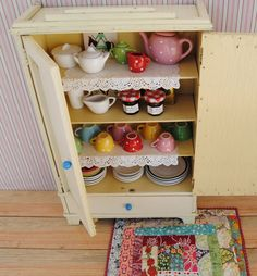 Unique 1950's vintage miniature TOY CHINA CABINET - handmade wooden cabinet with drawer and shelves - painted in white/eggshell colour (02). €60,00, via Etsy.