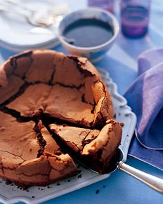 Passover Dessert Recipes | Martha Stewart Living - The perfect ending to a perfect seder usually involves chocolate. This flourless cake is dense yet crumbly; a hint of coffee in the batter and the glaze intensifies the chocolate.