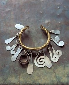 Bracelet | Alexander Calder.  Brass, silver and steel wire.  ca. 1930