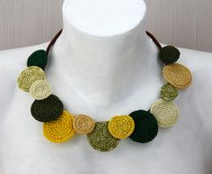 Art-looking statement necklace! The basic string is hand made by me from a cotton thread wrapped around a cord, the necklace is buttoning with a wooden bead. Ornamental circles are 7/8 to 1 1/2 inches of size. Dimensions: length - approximately 18 inches (46 cm). Contact me for a