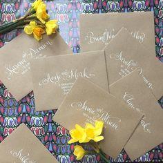 Modern calligraphy on wedding stationary in white ink   www.threebulletgate.com