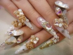 Amazing nails in pearls, iridescence, bling and golds.