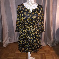 Sunflower Sundress Perfect for Spring! This black dress with sunflower pattern and tastefully cut out back is a must have ! American Rag Dresses Long Sleeve