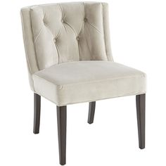 Elegant yet practical, our Gisle Dining Chair is suited for dinner parties as well as kid-friendly occasions. The sophisticated lines, espresso wood frame and hand-tufted details beautifully belie the fact that the polyester velvet upholstery is made for tougher stuff. Further proof that you can't judge a book by its cover.
