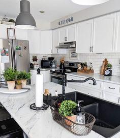 100 Stunning Farmhouse Kitchen Decor Ideas You Have to Try - You have to see this #farmhousekitchen decor idea with silver fridge and various kitchen signs. Love it! #FarmhouseKitchen #HomeDecorIdeas
