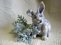 A personal favorite from my Etsy shop https://www.etsy.com/listing/89259706/sale-bunny-rabbit-sculpture-gift-idea