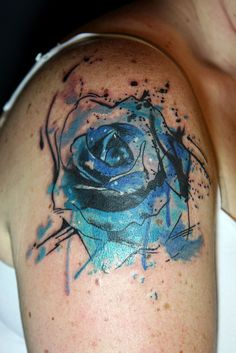 abstract watercolor blue rose tattoo