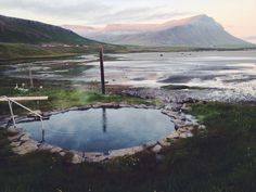 Natural hot spring in the Westfjords of Iceland