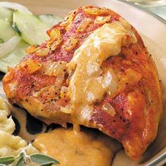 Hungarian Chicken Paprikash Recipe -My mom learned to make this tender chicken dish when she volunteered to help prepare the dinners served at her church. It's my favorite main dish, and the gravy, seasoned with paprika, sour cream and onions, is the best. —Pamela Eaton, Monclova, Ohio