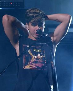 The arms. The hair. And then it is freaking Calum Hood.... I can't I just can't....