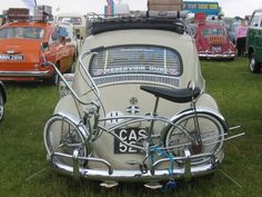 Cool low rider bike strapped to the back of a bug