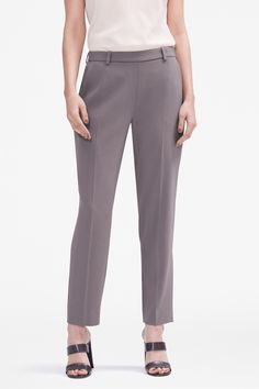 These flat-front trousers are a step above your standard work pant thanks to their clean, tailored lines and flattering tab closure that sits slightly below the natural waist.