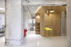 Raised wooden bed with sliding wardrobes in a small modern apartment in Shanghai Shanghai, Ikea Hacks, Yellow Kitchen Cabinets, Hidden Toilet, Foldable Dining Table, Interior Design Degree, Journal Du Design, Bed With Slide, Apartment Renovation