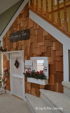 A real life playhouse under the stairs. SO AWESOME.