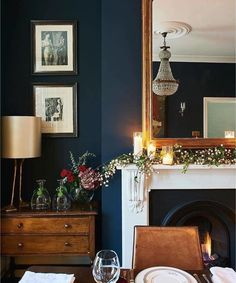 Deep blue walls in littlegreenepaintcompany's Basalt Absolute Matt Emulsion make a good foil for brown furniture, adding a refreshing twist to a traditional table setting. diningroom fireplace interior Photograph Jonathan Gooch, design by Emma Collins My Living Room, Home And Living, Dark Walls Living Room, Cozy Living, Dark Wood Furniture Living Room, Mocha Living Room, Modern Living, Sweet Home, Interior Desing