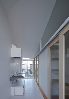 Kyoto studio Alphaville has squeezed an angular concrete apartment building onto a small plot in the Japanese city of Hikone Japan Apartment, Interior Architecture, Interior Design, Kitchen Dinning, Laundry In Bathroom, Japanese House, Home Studio, Studio Apartments, Small Spaces