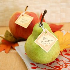 Add a fancy tag to a fresh pear or peach to add some simple sweetness to your wedding.    Find out how to make them at  Beaucoup .