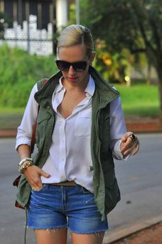Forever classic. Military vest, white button down blouse, and denim shorts at a…