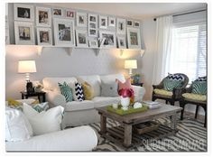Small living room with photo Display. Very nice colors and looks cozy!