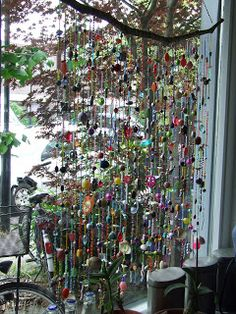 Suncatcher / window hanger with a lot of beads and shells. I'd rather turn this into a chandelier for the balcony! Bead Crafts, Diy And Crafts, Arts And Crafts, Beaded Curtains, Gypsy Curtains, Deco Nature, Deco Boheme, Deco Originale, Ideias Diy