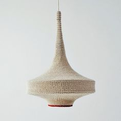 UK textile designer Naomi Paul's Gluck Lighting is hand-crocheted from remnants of yarn sourced from the couture industry