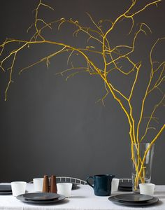 Sticks painted yellow! I tried this. I actually went in my neighbors (who have a HUGE maple tree) yard and picked up all the small grey branches and painted them. Some yellow, some grey. I then added tissue paper flowers, love birds, and ribbon. in the end i would up hating it and will probably throw it away. Just saying. -Ashleigh