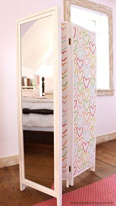 This darling divider that doubles as a mirror: | 16 Totally Doable DIY Projects That All Solve More Than One Problem