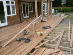 Fitting out a large deck in Eucalyptus wood.