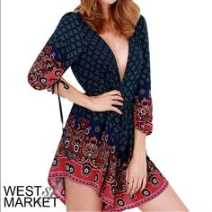 Gorgeous navy/red paisley printed jumper Deep V in front and back...zips up back to bottom of V- ties at neckline...long blouson sleeves with self ties at wrist- bought NWT on Posh doesn't fit! West SF Market Other