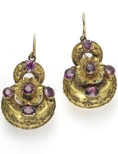 VICTORIAN GARNET EARRINGS. Victorian gold and almandine garnet earrings, with Etruscan style work, circa 1870.