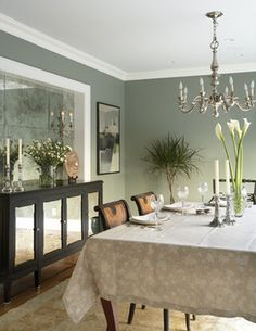This color reminds me of what we have in our dining room, except ours is a Muralo color...  This dining room has Benjamin Moore Herb Bouquet 460...  Both are nice greens with a blue undertone.
