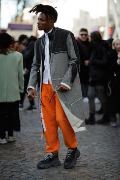 Photographer Eva Al Desnudo shoots attendees outside Virgil Abloh's OFF-WHITE's FW18 show in Paris. See what they wore here.