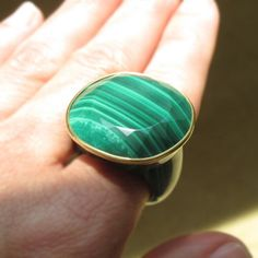 Malachite & 18K Gold Bold Statement Ring  In the Rio Grande you can get nice Malachite stones, Dramatic. Onyx also reasonable