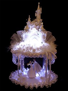 Cake topper! No need for a plain bride and groom... why not try Sleeping Beauty and her Prince dancing under their castle?