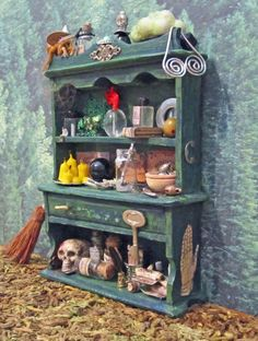 Miniature Witch Hutch with Free Standing Besom in Miniature Dollhouse Scale Altered Hand Painted Fantasy Magical Treasuries Feature. $60.00, via Etsy.
