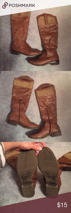 Brown Boots Used Lightly. Fits a 9.5 and a 10! Zipper on the inside. There is a small rip in the leather shown in the last picture. They are super comfy and go up to right below my knee and on the outside go up to my knee. The rips are not noticeable unless staring closely so no one will see when ur wearing them! Warn a couple times but haven't in a while so that's why I'm selling. Need space for new ones! Ask any questions and I am taking all offers! Candie's Shoes Combat & Moto Boots