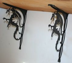 WAS $150 NOW $125 !!  These custom dragon shelf brackets are made of recycled steel that has been painted flat black. They measure approximately 11 long by 15 high and are extremely sturdy with each bracket able to support up to 100lbs.  This listing is for a pair (2) backets.  The inspiration for these brackets came from my daughters Bearded Dragon. We thought he was so cool he deserved special shelves to hold up his cage. He loves them ! If these dragons are not your style let us know what…