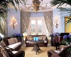 Spacious Tropical Living Room with soft cool pastel color scheme
