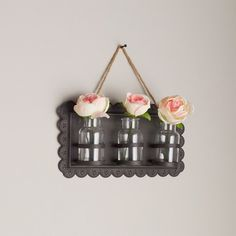 "Add a sprinkle of romantic cottage style to your home with this petite  embossed  metal wall decor with 3 clear glass vases. Add flowers from your garden for a personal touch. (8.25""Hx15.25""W)"