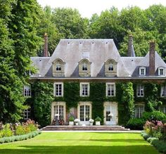 Exterior: This English Country house has a tall, steep roof, and dormers. The house is very symmetrical, and so are the windows. There are vines growing on the exterior of the house, and 4 chimneys. Style At Home, French Chateau, French Colonial, House Goals, Home Fashion, My Dream Home, Dream Big, Old Houses, Curb Appeal