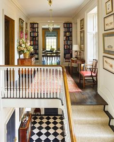 Love this area! The stairs, bookcases,black and white flooring, everything!