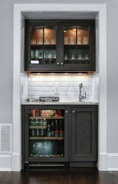 Media Room. Snack Bar Ideas. Glass Faced Cabinets. White Subway Tile Backsplash. Bar Sink.