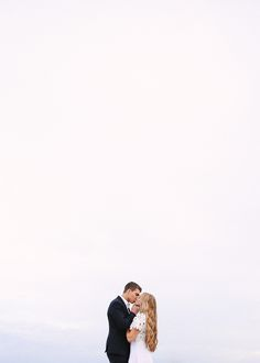 Mandi Nelson Photography - neat perspective of bride and groom with lots of white space