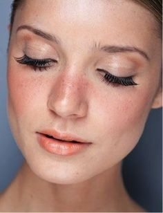 Let your natural beauty shine with a light coral stain and a strip of falsies.