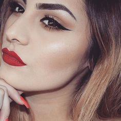 Nothing beats a velvet red lip and an intense black wing.