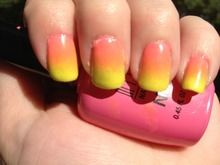 This photo doesn't really seem to do the colors justice. It's hard to see the pink at the base...but hey, I think it still came out pretty good. This is my second attempt at doing gradient nails and I think I'm starting to get the hang of it!    The bright pink and yellow I used originally made me think of a summery lemonade...but, it turned out more like a sunset. I'll have to try a new lemonade-inspired look.