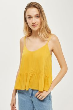 Need a wardrobe refresh? Camisoles are having a big moment and especially when they come in bright bold colours like mustard.